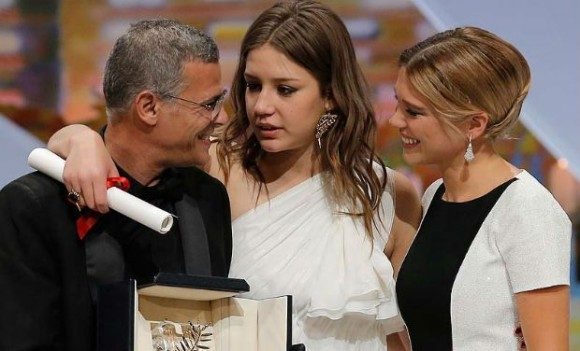 From left to right: director Abdellatif Kechiche and stars Adele Exarchopoulos and Lea Seydoux, with the Palme d'Or, the top prize at the Cannes Film Festival.