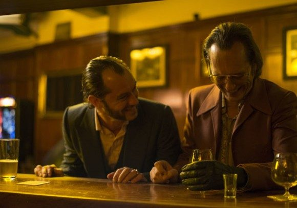 "Jude Law as the titular character ""Dom Hemingway"" alongside his partner-in-crime played by Richard E. Grant."