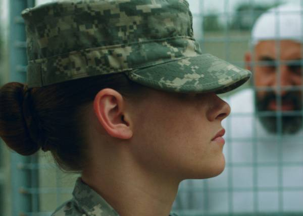 Kristen Stewart play a prions guard in Camp X-Ray