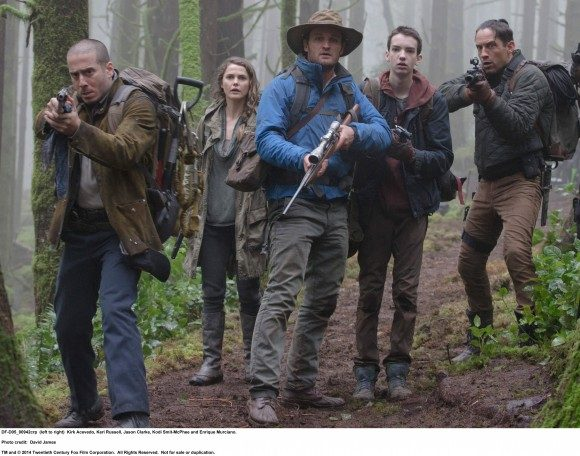 Jason Clarke (center) leads a group of humans on a foray into ape territory