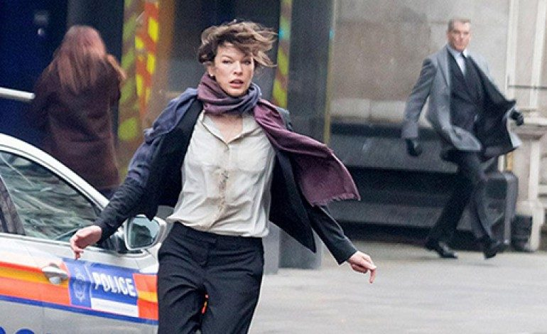 Watch Milla Jovovich Face-Off Against Pierce Brosnan in 'Survivor' Trailer