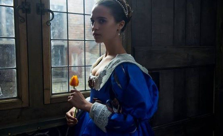 Dane DeHaan and Alicia Vikander Get Steamy in the 'Tulip Fever' NSFW Red Band Trailer