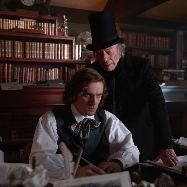 Dan Stevens (left) stars as Charles Dickens and Christopher Plummer (right) stars as Ebenezer Scrooge.